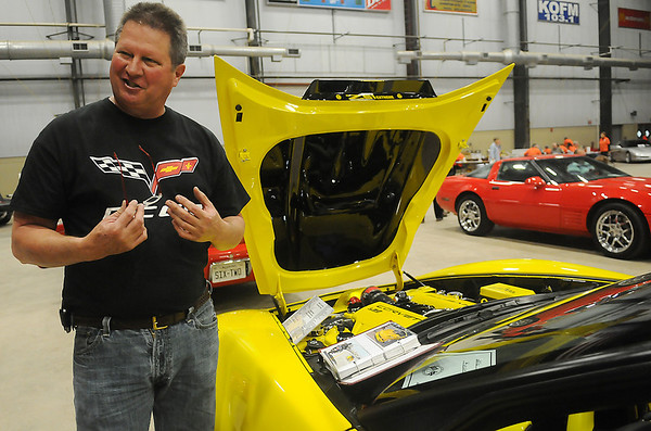 Kevin Lowe discusses the modifications on his 2006 Z51 Coupe during the Corvettes of Enid Car Show at the Chisholm Trail Coliseum Saturday, April 6, 2013. (Staff Photo by BONNIE VCULEK)