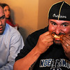 Lance Franklin (right) devours a Wings to Go chicken wing as Robert Faulk (left), from the Enid Noon AMBUCS, checks out his competition during a wing eating contest at the 4RKids Baseball Tournament Meet & Greet at Oakwood Mall Friday, April 5, 2013. More than 25 teams registered for the Saturday and Sunday tournament that will raise funds for the new Miracle League baseball field at the AMBUCS ABC Park. (Staff Photo by BONNIE VCULEK)