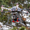 A remote controlled, HD camera-equipped hex copter hovers above the ground near the entrance to KJ Productions Thursday, April 04, 2013. Jack Quirk, President and CEO of KJ Productions uses the equipment to record low-level aerial video and photography for the local company's clients. (Staff Photo by BONNIE VCULEK)