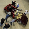Corvette enthusiasts admire one of the vehicles on display at the 21st annual Corvettes of Enid Car Show at the Chisholm Trail Coliseum Saturday, April 6, 2013. (Staff Photo by BONNIE VCULEK)