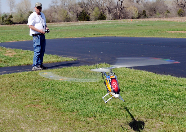 Ron Rush lands his helicopter at Boomer Field Sunday, home of the SPADS RC Club. The club will have a special ceremony Saturday as they raise a flag over Boomer Field that once flew over Afghanistan. (Staff Photo by BILLY HEFTON)