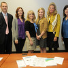 Jeff Moen, Sarah Chancy, Rachel Dillon, Kristin Van Horn and Marnie Taylor from the Oklahoma Center for Nonprofits, pause for a portrait with Ashley Ewbank from the Cherokee Strip Community Foundation prior to a nonprofits seminar luncheon at the CDSA Non-Profit Center Friday, April 5, 2013. (Staff Photo by BONNIE VCULEK)