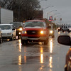 As sleet falls, drivers carefully negotiate slush covered roads in Enid early Wednesday, April 10, 2013. (Staff Photo by BONNIE VCULEK)