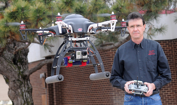 Jack Quirk, President and CEO of KJ Productions, flies a remote controlled, HD camera-equipped hex copter that provides an aerial perspective, enhancing video production by the locally owned business for their clients. (Staff Photo by BONNIE VCULEK)