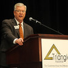 John Berg, Triangle Insurance CIC President and CEO, presents his annual report at the company's meeting at Convention Hall Thursday, April 25, 2013. (Staff Photo by BONNIE VCULEK)