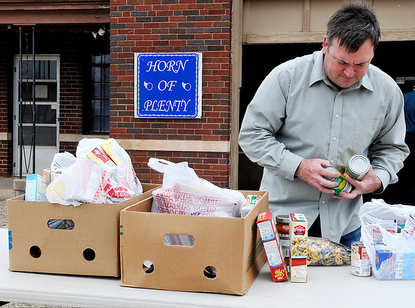 Kip Nelson was among the volunteers sorting through the boxes of food donated to Horn of Plenty during their spring food drive Sunday. (Staff Photo by BILLY HEFTON)