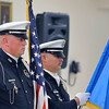 Members of the Enid Police Department Honor Guard presents the colors during the Crime Victims' Vigil Tuesday at the YWCA. (Staff Photo by BILLY HEFTON)