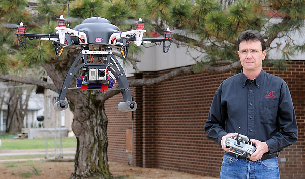 Jack Quirk, President and CEO of KJ Productions, flies a remote controlled, HD camera-equipped hex copter that provides low-level aerial video and photography for their clients. (Staff Photo by BONNIE VCULEK)