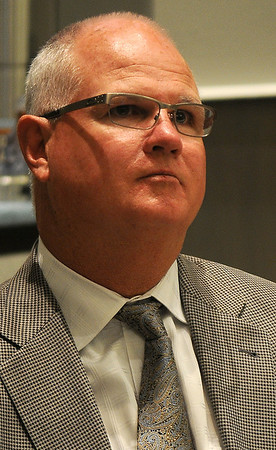 """Jim Morris listens as John Berg, CIC President and CEO, addresses the guests during his annual report at the Triangle Insurance meeting at Convention Hall Thursday, April 25, 2013. . Morris, whose story was told in the movie """"The Rookie,"""" was the keynote speaker at the event. (Staff Photo by BONNIE VCULEK)"""