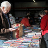 Avid readers search thousands of book titles during the Hospice Circle of Love spring book sale Friday, April 12, 2013. Book prices are $1 for hardback copies and 50 cents for paperback novels with proceeds from the fundraiser benefiting Hospice clients. (Staff Photo by BONNIE VCULEK)