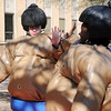 Marisha Wallace (left) and Nicole Anusim high-five before their sumo wrestling match during the Northern Oklahoma College Spring Fling Thursday, April 11, 2013. (Staff Photo by BONNIE VCULEK)