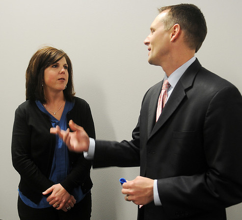 Ashley Ewbank (left), from the Cherokee Strip Community Foundation in Enid, listens as Oklahoma Center for Nonprofits Alliance Chairman,  Jeff Moen, answers a question about the need for nonprofits to unify to survive during a working seminar at the CDSA Non-Profit Center Friday, April 5, 2013. (Staff Photo by BONNIE VCULEK)