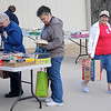 Joyce Pralle (right), from Fairmont, checks for traffic as she leaves the Hospice Circle of Love spring book sale Friday, April 12, 2013. Avid readers search thousands of book titles at bargain prices of $1 for hardback copies and 50 cents for paperback novels during the event. (Staff Photo by BONNIE VCULEK)