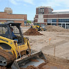 Heavy equipment operators continue the dirt work at the downtown Enid Event Center Thursday, April 25, 2013. (Staff Photo by BONNIE VCULEK)