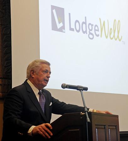 Dave Owen, with Partner LodgeWell Group, LLC, addresses guests about the new downtown Enid hotel during the Enid Regional Development Alliance quarterly luncheon at Oakwood Country Club Thursday, April 18, 2013. (Staff Photo by BONNIE VCULEK)