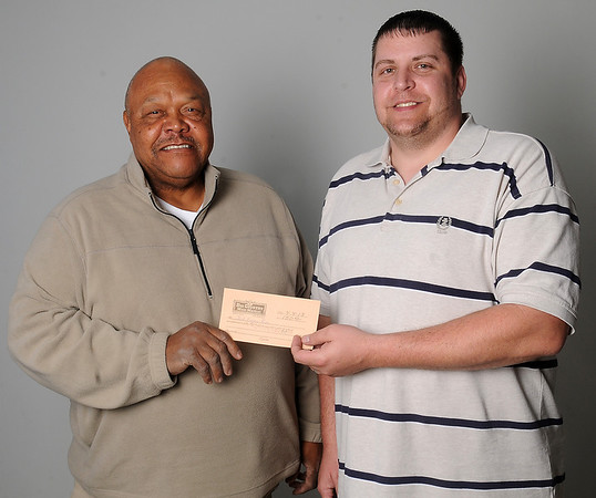 Joel Eugene Ross, from Watonga, accepts a $150 gift certificate to Big Country Meat Market from James Cross at the Enid News & Eagle. Ross, who completed the basketball bracket for the first time, won the NCAA Men's bracket contest sponsored by the Enid News & Eagle. (Staff Photo by BONNIE VCULEK)