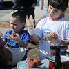 Maddox and Madison Nulph prepare their gourmet meatballs during the 1st annual Pelagic Tank Kids Q at the 8th annual Roberts Ranch Smokin' Red Dirt Barbeque Friday, April 19, 2013. (Staff Photo by BONNIE VCULEK)