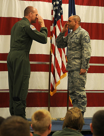 Col. Darren James salutes Master Sgt. Kendall Kirk after presenting Kirk with the Inspector General's Coin during the CUI Picnic at the Armed Forces Reserve Center Thursday, April 18, 2013. Kirk, the contracting officers representative superintendent, was one of five receiving the special honor. (Staff Photo by BONNIE VCULEK)