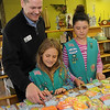 "Hope Outreach executive director Matt Lohman (back, left) receives ""Sparkling Hope"" handcrafted items from Katie Roberts and Emma Harbuck at the Hope Outreach Thrift Store Thursday, April 18, 2013. Nearly 100 items were created by six of the girls in Troop 211 as part of their bronze award project. (Staff Photo by BONNIE VCULEK)"