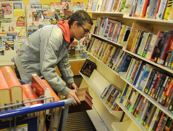 Malvin Arter shelves books at Park Avenue Thrift Wednesday, April 03, 2013. (Staff Photo by BONNIE VCULEK)