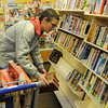 Malvin Arter shelves books at Park Avenue Thrift Wednesday, April 03, 2013. (Staff Photo by BONNIE VCULEK)