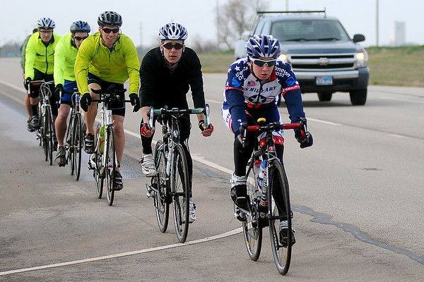 Members of the Vance Air Force Base bicycle club ride return to the base after riding to Little Bit of Seattle in Waukomis and back Saturday, April 13, 2013. The trip was their first ride together along U.S. 81. (Staff Photo by BONNIE VCULEK)