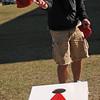 Devan Rhode tosses a bean bag during Northern Oklahoma College's Spring Fling Thursday, April 11, 2013. (Staff Photo by BONNIE VCULEK)