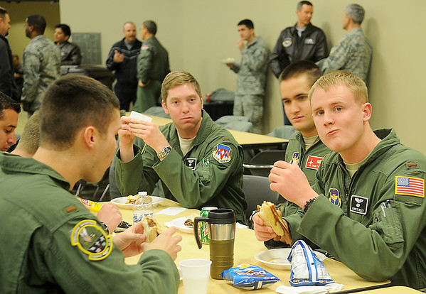Vance Air Force Base pilots enjoy sliced brisket sandwiches during the CUI Picnic at the Armed Forces Reserve Center Thursday, April 18, 2013. Col. Darren James announced that Team Vance had received an overall CUI Rating of Satisfactory during the special awards ceremony. (Staff Photo by BONNIE VCULEK)