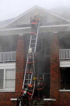 Enid firefighters battle a blaze at 412 W. Pine Wednesday, April 17, 2013. (Staff Photo by BONNIE VCULEK)