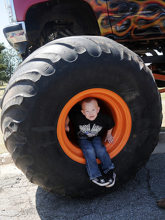 Austin Kunkel, 4, checks out Grandpa Bruce Kunkel's Sudden Death monster truck during a picnic at Meadowlake Park Sunday, April 21, 2013. (Staff Photo by BONNIE VCULEK)