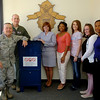 Lt. Col. Royce Terry, Col. Darren James, and PreventionWorkz staff pause near the new unused prescription drug drop box in the Vance Air Force Base 71st Security Forces building Friday, April 25, 2014. (Staff Photo by BONNIE VCULEK)