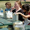 Emme Hamil (center) and Lillie Dunkin (right), from Chisholm Elementary School, eat lunch with their classmates during their pioneer school days at Humphrey Heritage Village Wednesday, April 23, 2014. (Staff Photo by BONNIE VCULEK)