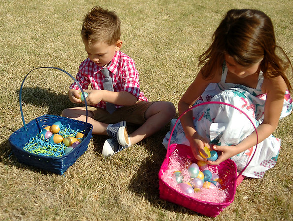 Brock and Brylee Nehring (from left) reveal their candy surprises at Oakwood Christian Church's Easter Eggstravaganza Saturday, April 19, 2014. More than 20,000 colorful eggs adorned the church lawn as children ages infant-5th grade participated in six different egg hunts at the community event. (Staff Photo by BONNIE VCULEK)