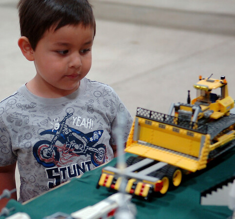Nicolas McCaslin, 4, glances at one of the Lego models on display during the Cherokee Strip Model Railroad Association Railfest at the Chisholm Trail Expo Center Saturday, April 19, 2014. (Staff Photo by BONNIE VCULEK)