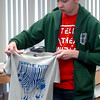 Jordan McCrary holds up his graphic arts t-shirt after screen printing the design at Privation Printing Thursday, April 17, 2014. Students in graphic arts classes at Autry Technology Center created shirt designs and learned the screen print process from Timothy Larsen, owner of Privation Printing, an incubator company in the James W. Strate Center for Business Development at 2020 Willow Run Street. (Staff Photo by BONNIE VCULEK)