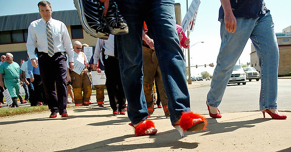 """As traffic heads west on Owen K. Garriott, more than 70 men were """"Man Enough"""" to wear women's high heels during the YWCA Walk a Mile in Her Shoes Tuesday, April 22, 2014. (Staff Photo by BONNIE VCULEK)"""