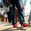 "As traffic heads west on Owen K. Garriott, more than 70 men were ""Man Enough"" to wear women's high heels during the YWCA Walk a Mile in Her Shoes Tuesday, April 22, 2014. (Staff Photo by BONNIE VCULEK)"
