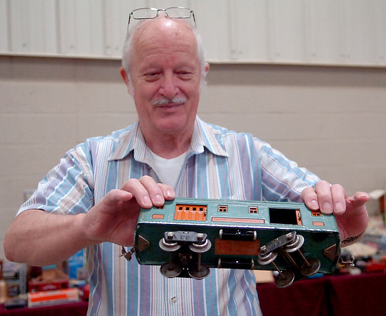Elmer Sheely, from Oklahoma City, holds an original, standard size model train Baggage Car No. 322 during Railfest at the Chisholm Trail Expo Center Pavilion Saturday, April 19, 2014. Sheely began collecting Lionel, American Flyer and Marx antique model and toy trains approximately 6 years ago with his wife, Santiaga. (Staff Photo by BONNIE VCULEK)