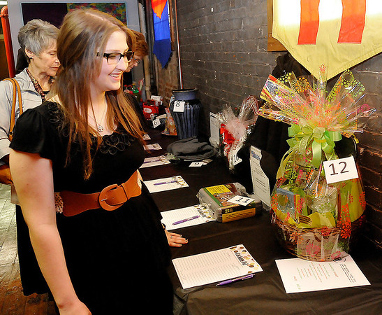 Leonardo's Children's Museum's Junior Volunteer of the Year, Rachael Killam, looks at silent auction items priot to the awards ceremony Thursday. (Staff Photo by BILLY HEFTON)
