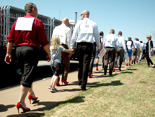 More than 70 men strut in high heels from the YWCA to RSVP during the Walk a Mile in Her Shoes Tuesday, April 22, 2014. The fundraising event raised awareness during sexual assault month. (Staff Photo by BONNIE VCULEK)