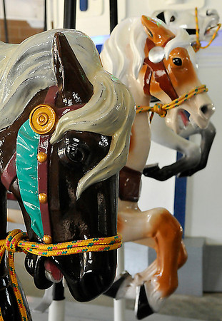 Horses in place at the carousel at Meadowlake Park Monday. The carousel is scheduled to open Memorial Day. (Staff Photo by BILLY HEFTON)
