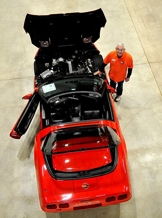 Dennis Voth stands next to his Corvette at the Corvette Expo XXII Saturday at the Chilsholm Trail Expo Center. (Staff Photo by BILLY HEFTON)