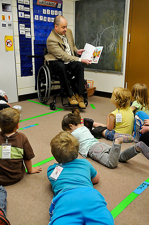 Representative John Enns reads to students at the Westside Head Start Center Friday. (Staff Photo by BILLY HEFTON)