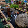 Unique water features by Ponds-n-Lillies, from Enid, attract Enid Home Show customers Saturday, April 26, 2014. (Staff Photo by BONNIE VCULEK)