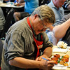 Andrew Putnam scores entries Saturday during the Red Dirt Barbeque contest. (Staff Photo by BILLY HEFTON)