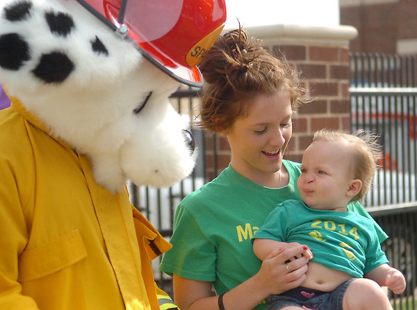 Rebecca Jane King (right), the 2014 March of Dimes ambassador, reacts as Sparky greets her during the March of Dimes March for Babies at Convention Hall Saturday, April 26, 2014. (Staff Photo by BONNIE VCULEK)