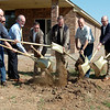 Dignitaries break ground for the new geothermal Energy Star homes in Chisholm Creek Village. David Ritchie (third from right) says plans include finishing Chisholm Creek Village streets and at least 15 homes in the next year. (Staff Photo by BONNIE VCULEK)