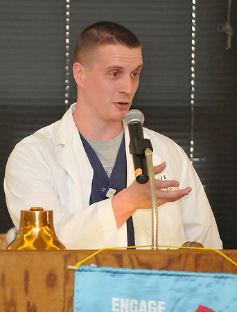 Dr. Chuck Jantzen, D.O. gestures as he speaks to the Enid Rotary Club Monday. (Staff Photo by BILLY HEFTON)