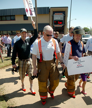 More than 70 men wear women's high heels during the YWCA Walk a Mile in Her Shoes Tuesday, April 22, 2014. (Staff Photo by BONNIE VCULEK)