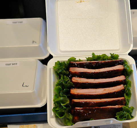 A box of ribs are presented to be judged at the Red Dirt Barbeque contest Saturday. (Staff Photo by BILLY HEFTON)